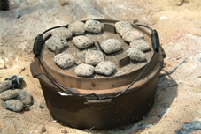 camp oven cooking bbq briquettes